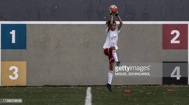 Girl catches a ball during a slection test to be part of the Sao Paulo FC under-15 female football team in Sao Paulo, Brazil, on April 22, 2019. -...