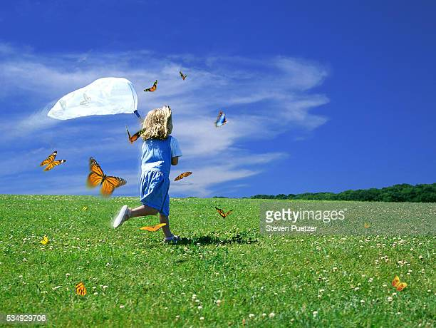 Girl catching butterflies with butterfly net