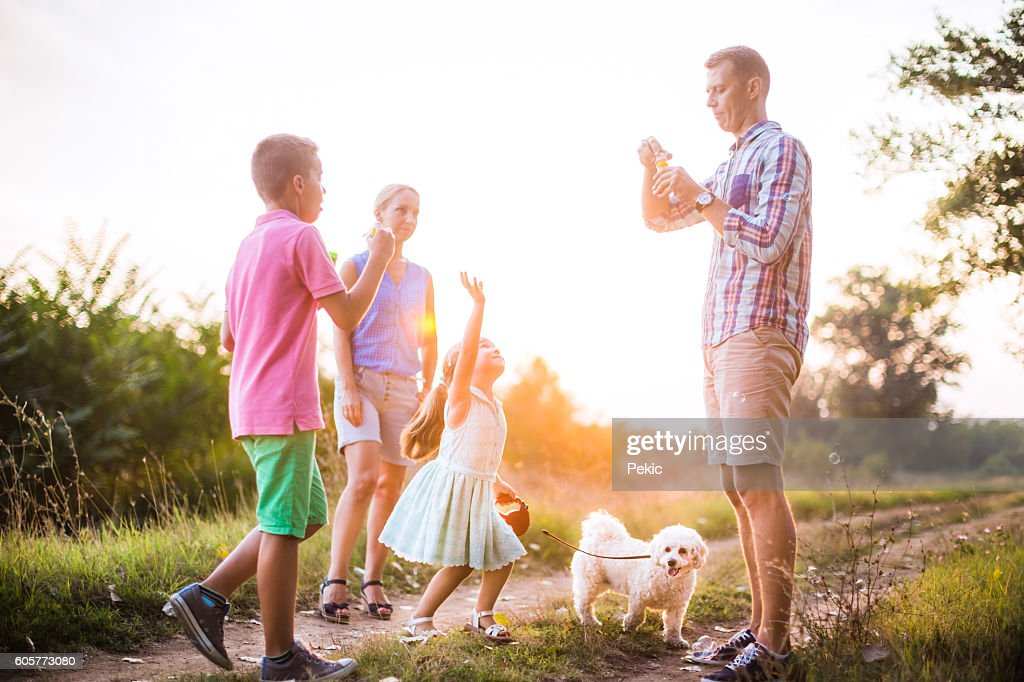 Girl catching soap bubbles! : Stock Photo