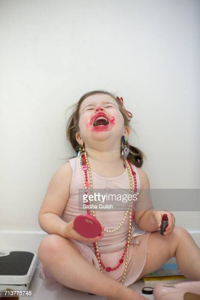 Girl caught out playing with lipstick