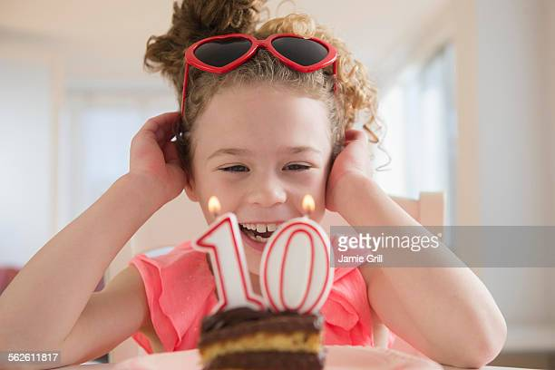 girl (10-11) celebrating 10th birthday - 10 11 years stock photos and pictures