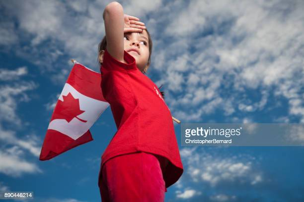 girl celebrating canada day - saluting stock pictures, royalty-free photos & images