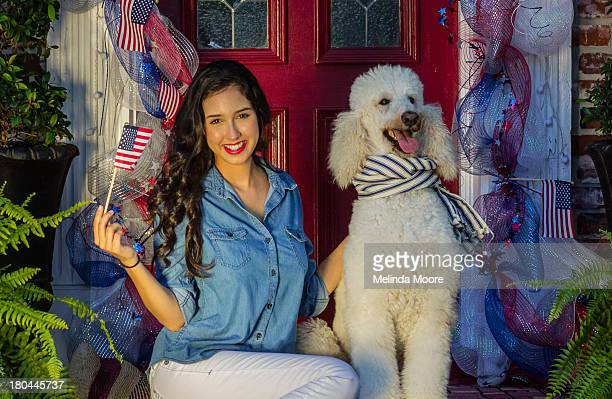 girl celebrating fourth of july with her poodle - standard poodle stock photos and pictures
