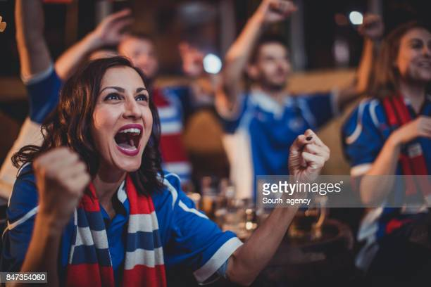 girl celebrating with friends - supporter stock pictures, royalty-free photos & images