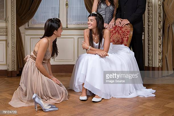 Girl changing shoes at quinceanera