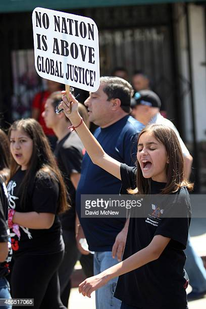 A girl chants while marching on the 99th anniversary of the Armenian Genocide calling for recognition and reparations on April 24 2014 in Los Angeles...