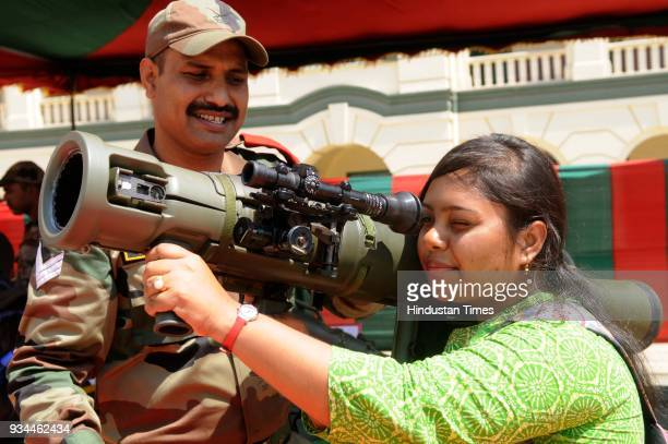 A girl checking rocket launcher during exhibition of Weapon and Equipment for public at under Headquarters Bengal Area at St Xavier's College Park...