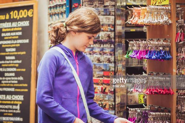 girl checking souvenirs in paris - souvenir stock pictures, royalty-free photos & images