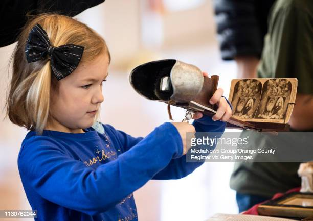 A girl checks out a stereoscope during Presidents Day activities at the Richard Nixon Library in Yorba Linda CA on Monday February 18 2019