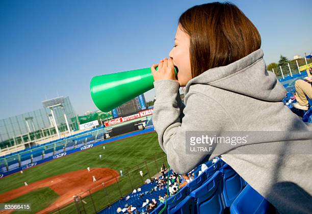 a girl cheers in a ballpark. - cheering ストックフォトと画像
