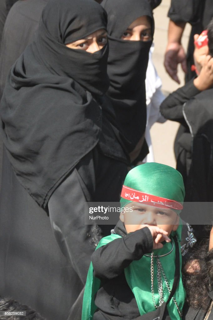 A girl child dressed in green and black take part in the prosseion to express their devotion during the 10th Ashura Procession of Muharramul Harram...