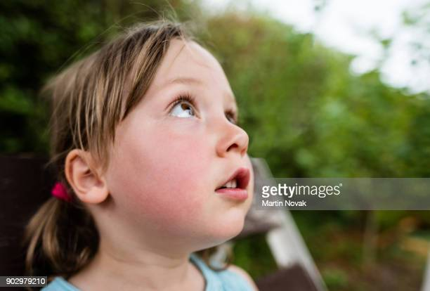 Girl child staring at something