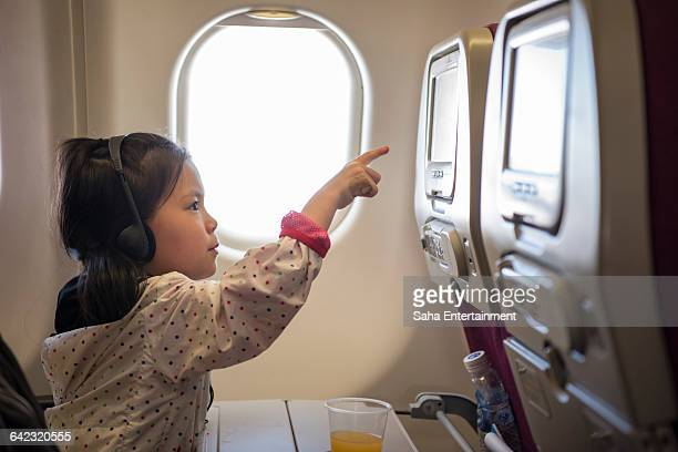 Girl choice the movie on the airplane
