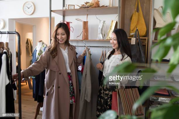 a girl choosing clothes. - luxury girl stock photos and pictures