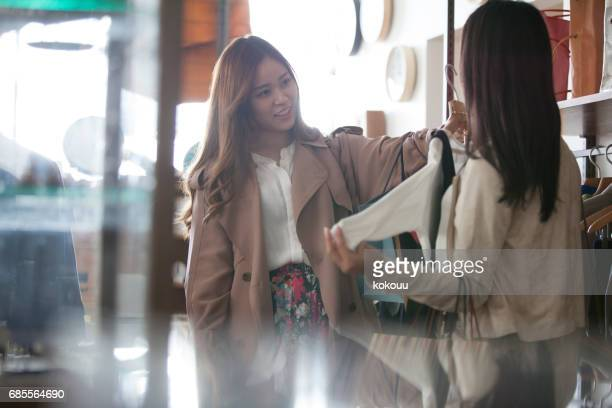 A girl choosing clothes.
