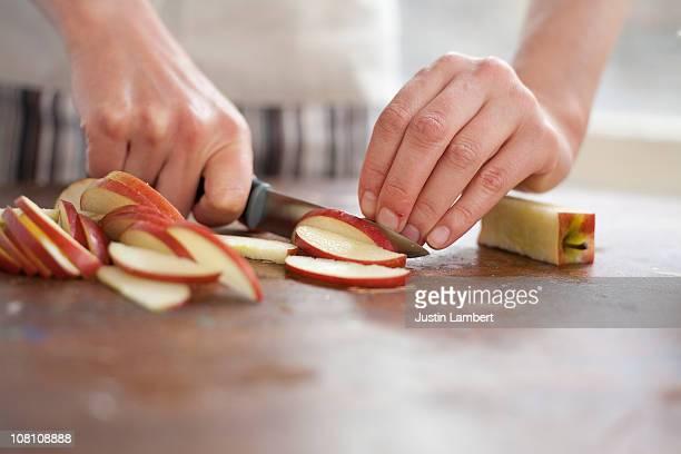 Girl chopping apple