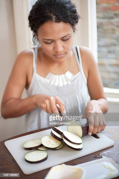 Girl chopping aubergine