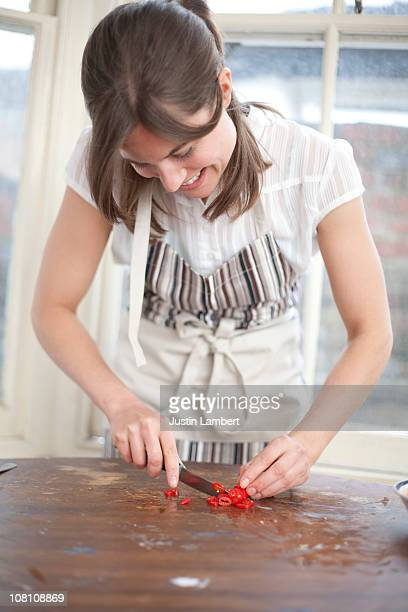 Girl chopping chillies