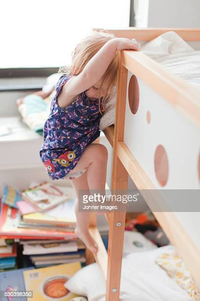 Girl climbing on bed