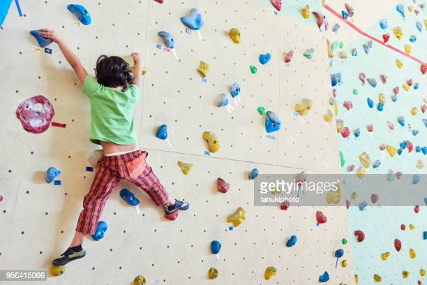 girl climbing - climbing stock pictures, royalty-free photos & images