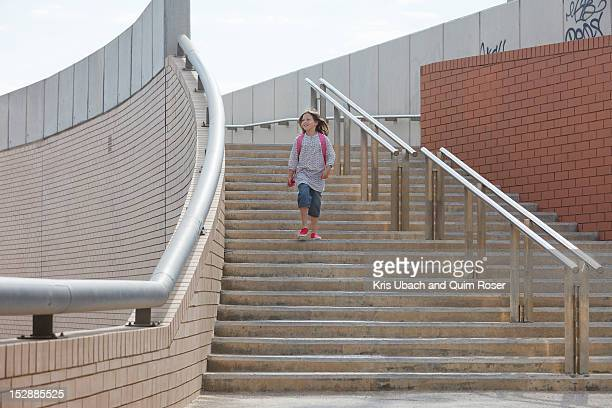 Girl climbing stairs outdoors