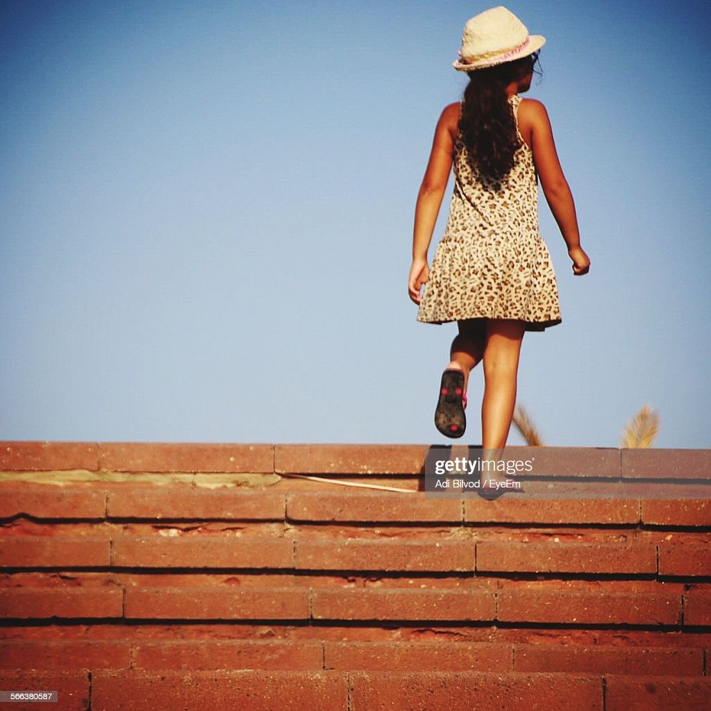 girl climbing steps against clear sky stock photo getty images