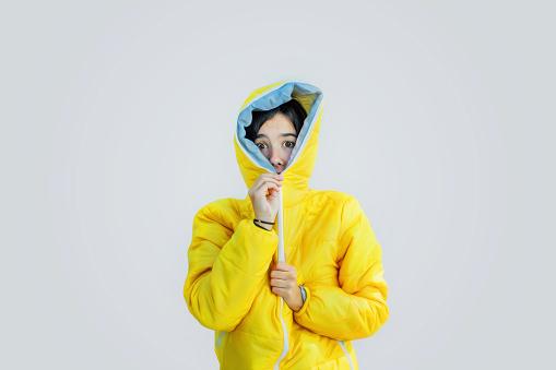 Girl closing zipper of wooden jacket - gettyimageskorea