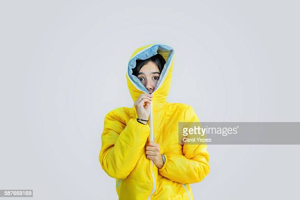 girl closing zipper of wooden jacket - cold temperature stock pictures, royalty-free photos & images