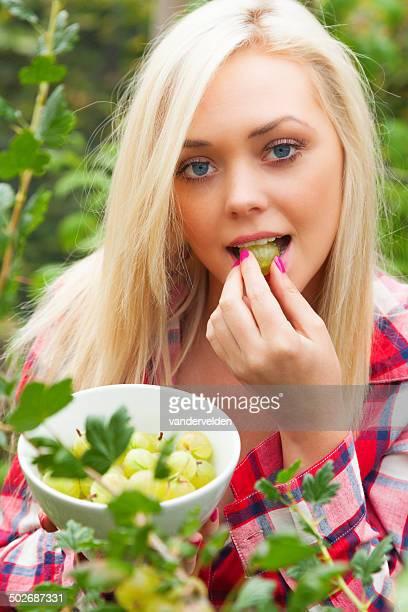 Girl Collecting Summer Fruit - Gooseberries