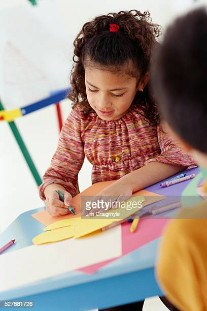 girl coloring in classroom - jim craigmyle stock pictures, royalty-free photos & images