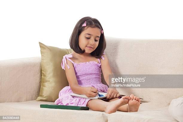 girl colouring in a book - colouring bildbanksfoton och bilder