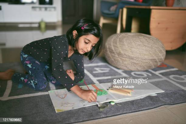 girl colouring picture at home - lockdown stock pictures, royalty-free photos & images