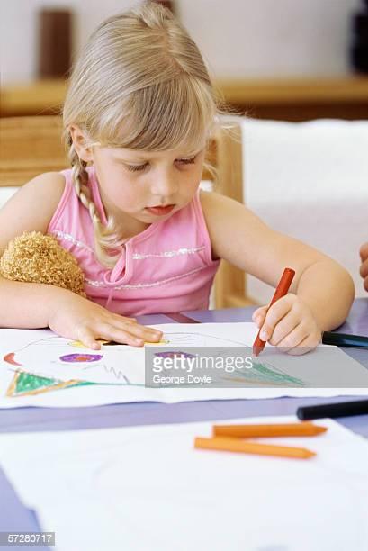 girl colouring with crayons - colouring bildbanksfoton och bilder