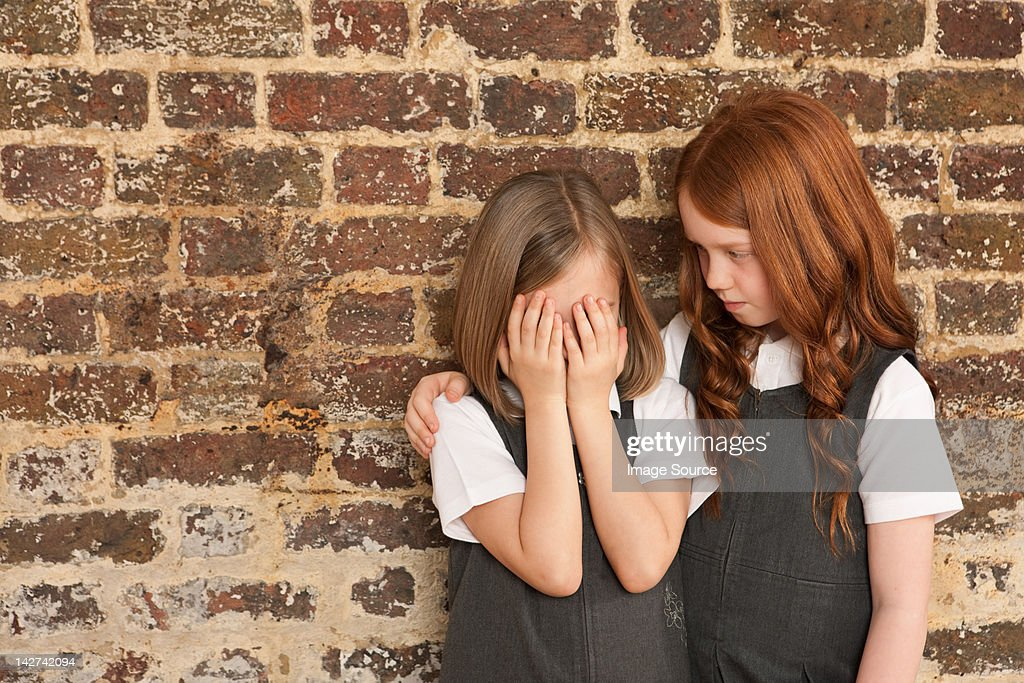 Girl comforting her friend : Stock Photo