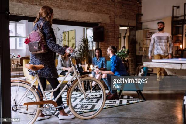 Girl Coming To Work With Bike