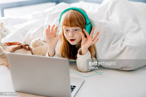 girl communicating via computer with friends and family - surfing the net stock pictures, royalty-free photos & images