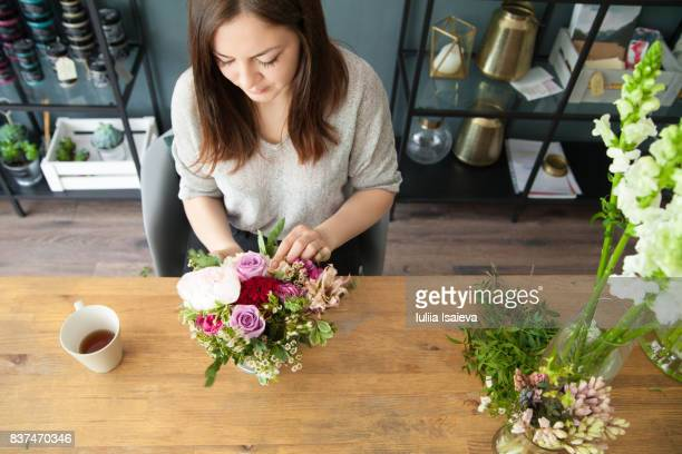 Girl composing small bouquet