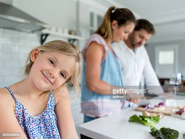 Girl cooking dinner with her family