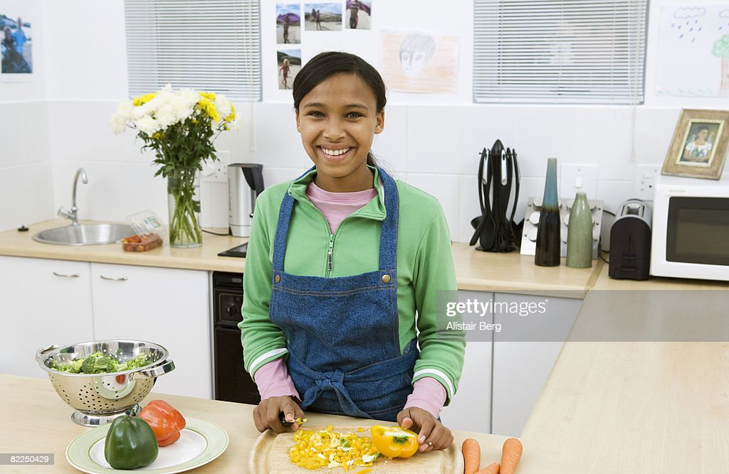 Girl cooking in kitchen : Stock Photo