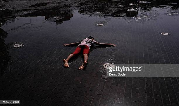 A girl cools down in a fountain in the Madrid Rio playground on September 5 2016 in Madrid Spain A threeday heatwave has hit central and southern...