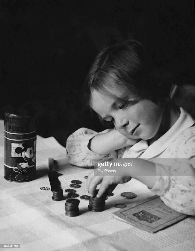 Wartime Savings : News Photo
