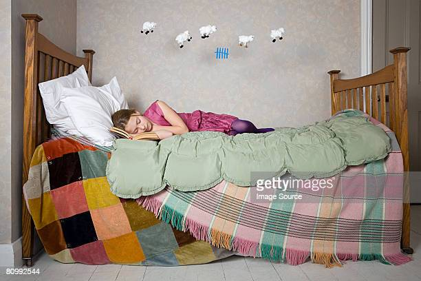a girl counting sheep - lying on side stock pictures, royalty-free photos & images