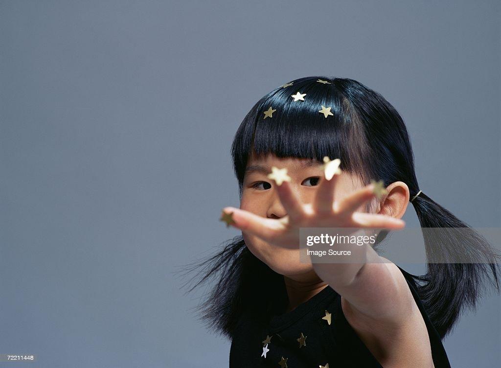 Girl covered in gold stars : Stock Photo