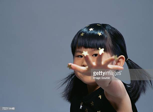 Girl covered in gold stars
