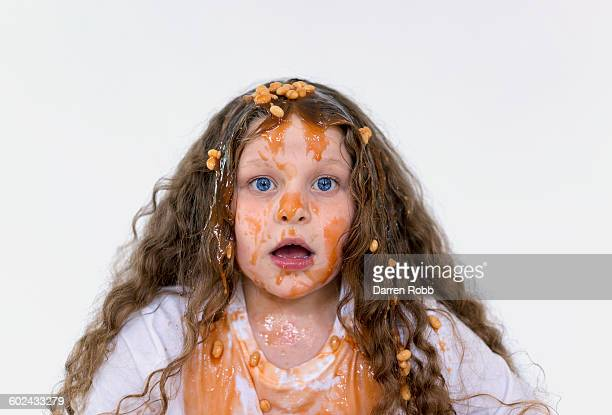 girl covered with baked beans - ugly kids stock photos and pictures