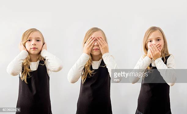 girl covering ears, eyes and mouth - see no evil hear no evil speak no evil stock pictures, royalty-free photos & images