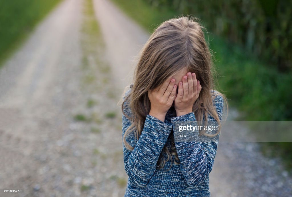 Girl covering face : Stock Photo