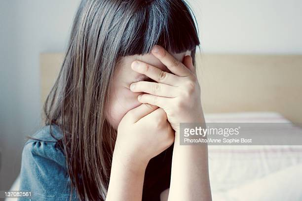 girl covering face with hands - obscured face stock pictures, royalty-free photos & images