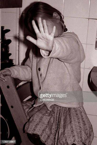 girl covering her face