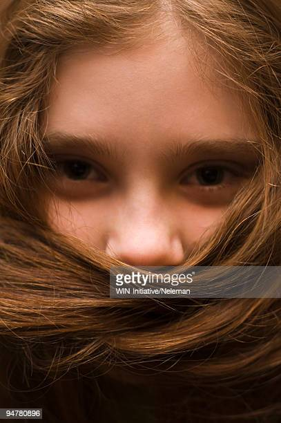 Girl covering her face with hair